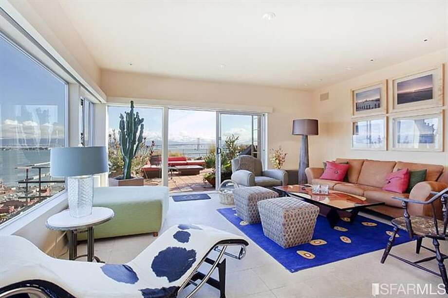 A unit in this building at 1441 Montgomery St., with expansive Bay Bridge views, is pending sale for $4.82 million. The listing says the building has units of multiple sizes and does not specify how many bedrooms are in the one that is pending sale.