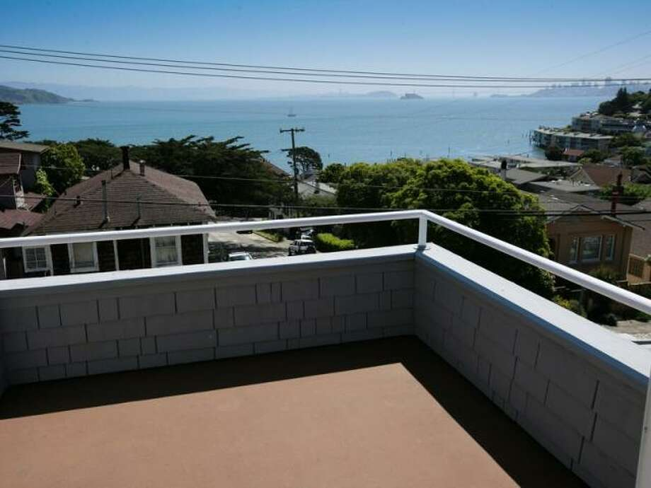 In Sausalito, there are actually single family homes from which you could watch the light show, as from this terrace view. This 3-bedroom, 2-bath house at 301 4th St. has a 1-bedroom, 1-bath in-law unit attached.It's listed for $1.55 million.