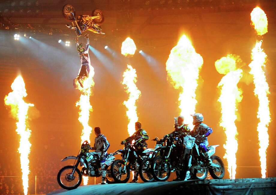 Pyrotechnics light up the stage during Nuclear Cowboyz, a show that mixes motocross with acrobatics and theatrics. Courtesy photo Photo: Courtesy Feld Entertainment