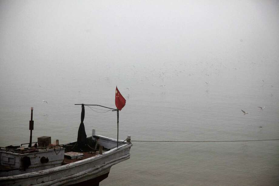 A boat berths in the heavy smog in Qingdao, east China's Shandong province on January 29, 2013. Residents across northern China battled through choking pollution on January 29, as air quality levels rose above index limits in Beijing amid warnings that the smog may not clear until January 31. Photo: STR, AFP/Getty Images / AFP