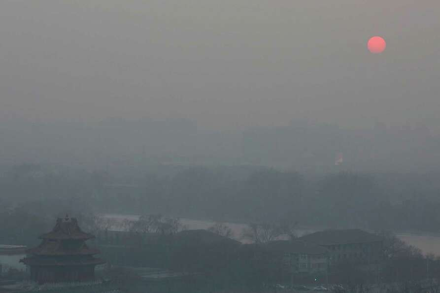 A general view of the pollution covered watchtower of the Forbidden City on January 16, 2013 in Beij