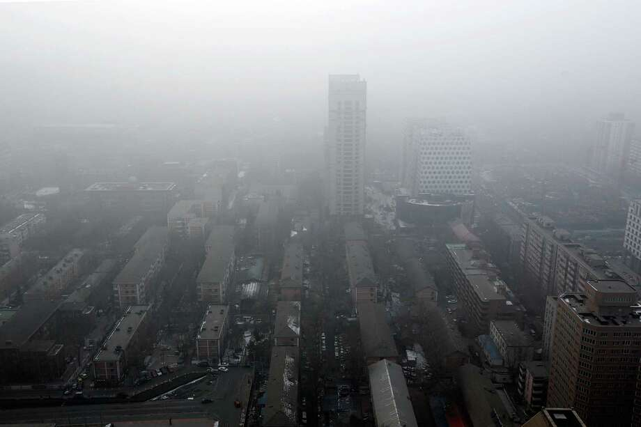 Severe pollution obscures the skyline on January 23, 2013 in Beijing, China. The air quality in Beijing on Wednesday hit serious levels as smog blanketed the city. Photo: Lintao Zhang, Getty Images / 2013 Getty Images