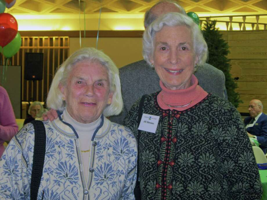 Members Margie Baylor, left, and Jill Stevens enjoy Staying Putís recent fifth birthday party at St. Markís Morrill Hall. Photo: Contributed