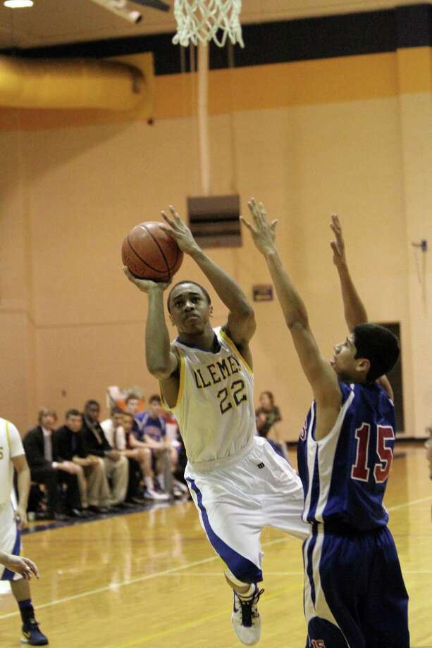 Clemens' William Gates (22) releases a leaner for two of his game-high 27 points Friday in the Buff's 81-70 win over Buda. Photo: Greg Bell, For The NE Herald