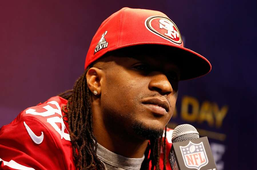 Dashon Goldson of the San Francisco 49ers answers questions from the media during Super Bowl XLVII