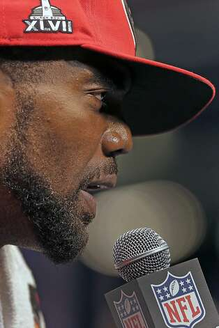 San Francisco 49ers wide receiver Randy Moss answers reporters questions during media day for the NFL Super Bowl XLVII football game Tuesday, Jan. 29, 2013, in New Orleans. Photo: Charlie Riedel, Associated Press