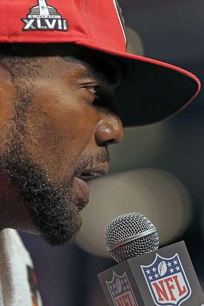 San Francisco 49ers wide receiver Randy Moss answers reporters questions during media day for the NF