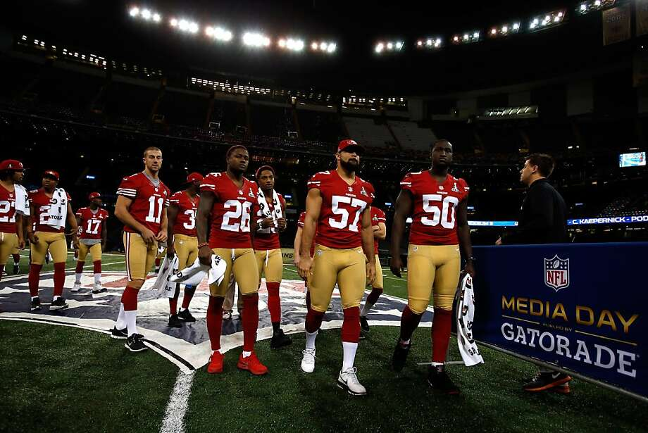 Alex Smith #11 ,  Tramaine Brock #26,  Michael Wilhoite #57 and  Cam Johnson #50 of the San Francisco 49ers walk onto the field for Super Bowl XLVII Media Day ahead of Super Bowl XLVII at the Mercedes-Benz Superdome on January 29, 2013 in New Orleans, Louisiana. Photo: Scott Halleran, Getty Images
