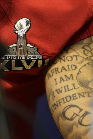 San Francisco 49ers quarterback Colin Kaepernick tattoo is seen as he answers reporters questions during media day for the NFL Super Bowl XLVII football game Tuesday, Jan. 29, 2013, in New Orleans. Photo: Mark Humphrey, Associated Press