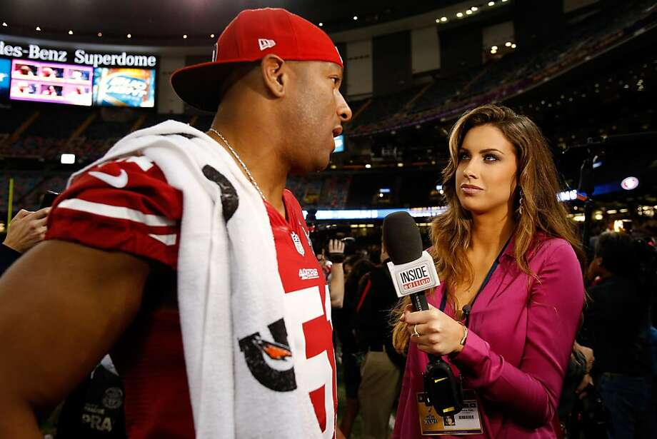 Clark Haggans of the San Francisco 49ers is interviewed by Katherine Webb of 'Inside Edition' during Super Bowl XLVII Media Day ahead of Super Bowl XLVII at the Mercedes-Benz Superdome on January 29, 2013 in New Orleans, Louisiana. Photo: Scott Halleran, Getty Images