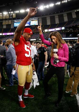 Clark Haggans of the San Francisco 49ers and Katherine Webb of 'Inside Edition' dance during Super Bowl XLVII Media Day ahead of Super Bowl XLVII at the Mercedes-Benz Superdome on January 29, 2013 in New Orleans, Louisiana. Photo: Chris Graythen, Getty Images
