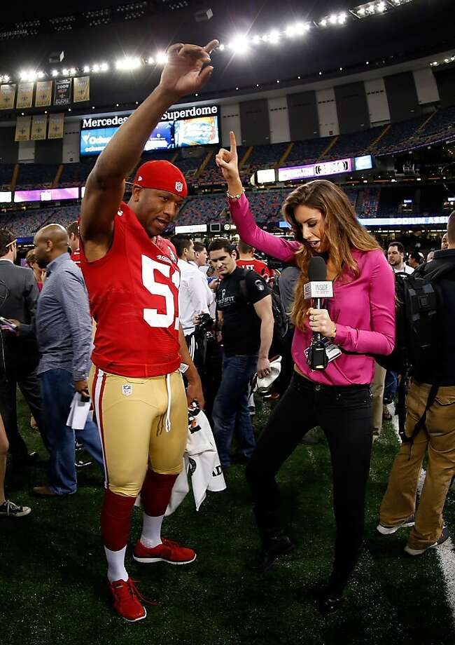 Former Miss Alabama Katherine Webb interviews the 49ers' Clark Haggans. Photo: Chris Graythen, Getty Images