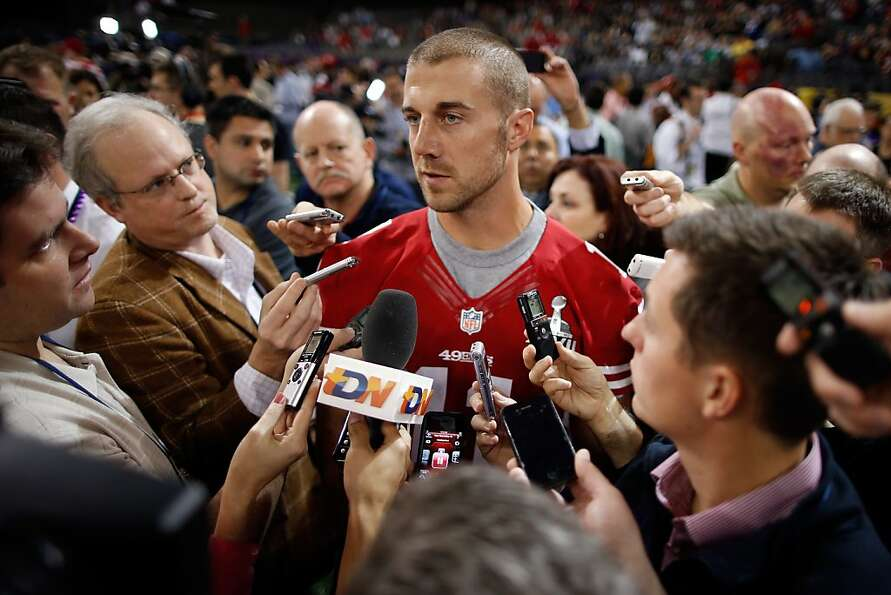 Alex Smith of the San Francisco 49ers answers questions from the media during Super Bowl XLVII Media