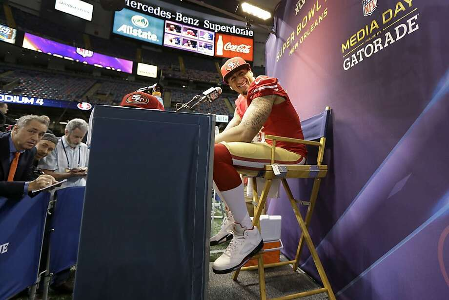 San Francisco 49ers quarterback Colin Kaepernick answers reporters questions during media day for the NFL Super Bowl XLVII football game Tuesday, Jan. 29, 2013, in New Orleans. Photo: Mark Humphrey, Associated Press