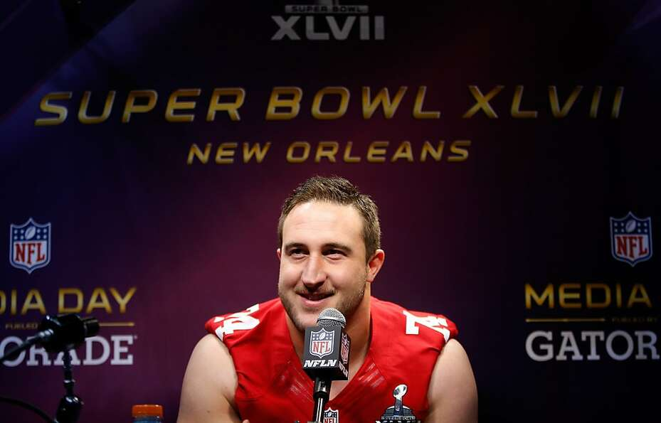 Joe Staley of the San Francisco 49ers answers questions from the media during Super Bowl XLVII Media