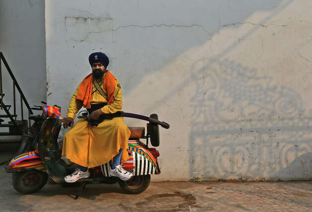 An Indian Sikh in his traditional dress waits for a religious procession to start towards the Sangam, the confluence of the rivers Ganges, Yamuna and mythical Saraswati, ahead of the Maha Kumbh festival in Allahabad, India, Saturday, Jan. 12, 2013. Millions of Hindu pilgrims are expected to take part in the large religious congregation of a period of over a month on the banks of Sangam during the Maha Kumbh festival in January 2013, which falls every 12th year. (AP Photo/Manish Swarup) Photo: Manish Swarup, ASSOCIATED PRESS / AP2013
