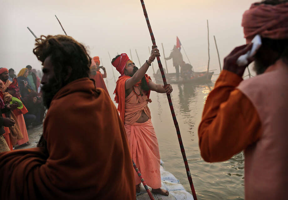 Indian Hindu holy men, or Sadhus, take part in a procession before taking a bath at Sangam, the confluence of the rivers Ganges, Yamuna and mythical Saraswati, ahead of the Maha Kumbh Mela in Allahabad, India, Sunday Jan. 13, 2013. Millions of Hindu pilgrims are expected to take part in the large religious congregation of a period of over a month on the banks of Sangam during the Maha Kumbh Mela in January 2013, which falls every 12th year. (AP Photo/Kevin Frayer) Photo: Kevin Frayer, ASSOCIATED PRESS / AP2013
