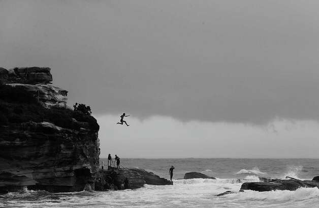 Children jump into a rock pool at Coogee Beach on Tuesday.  Photo: Mark Metcalfe, Getty / 2013 Getty Images