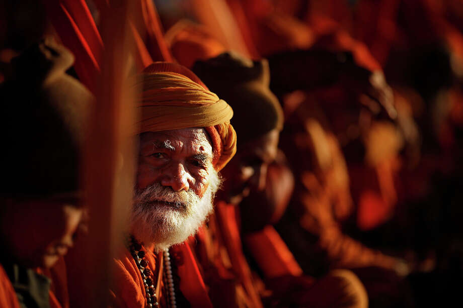 "Hindu holy men belonging to  ""ekadandi"", or single staff holding sect of Hindu holy men, waits for charitable food and money during the Maha Kumbh festival in Allahabad, India, Monday, Jan. 28, 2013. Millions of Hindu pilgrims are expected to attend the Maha Kumbh festival, which is one of the world's largest religious gatherings that lasts 55 days and falls every 12 years. The ""ekadandis"" are an ancient sect of traveling renunciates belonging to the Vaishnavite sect. (AP Photo/Saurabh Das) Photo: Saurabh Das, ASSOCIATED PRESS / AP2013"