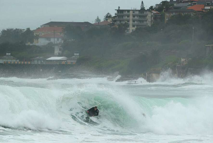 A surfer catches a nice wave at Coogee Beach on Tuesday in Sydney.