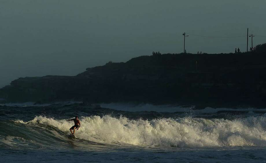 A surfer rides a wave at Coogee Beach on Tuesday in Sydney.   Photo: Mark Metcalfe, Getty / 2013 Getty Images
