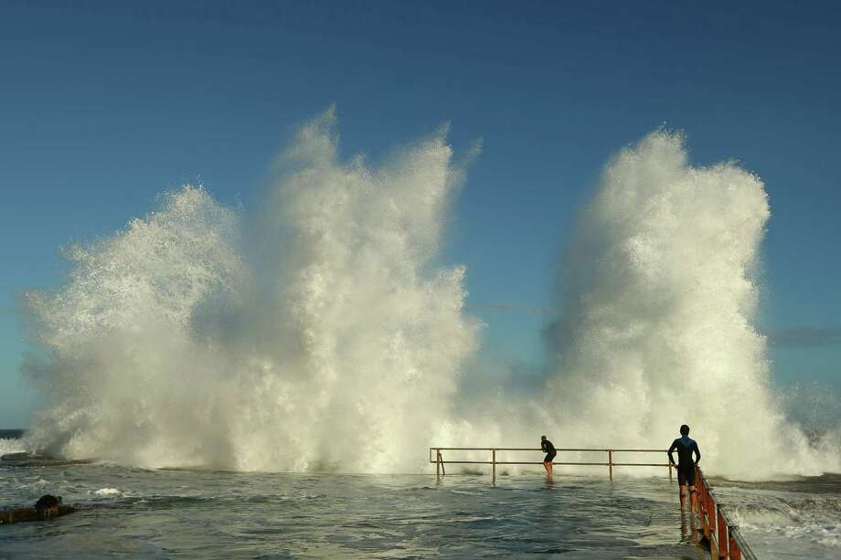 After a storm pounded Sydney, huge swells came ashore Tuesday.  Photo: Cameron Spencer, Getty / 2013 Getty Images