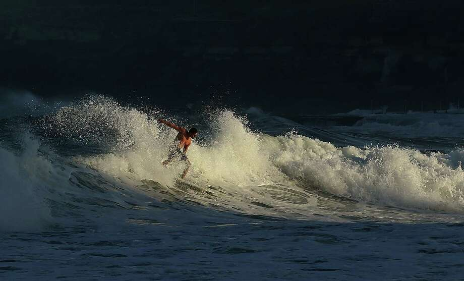 The surf was up. Here a surfer rides a wave at Coogee Beach Tuesday in Sydney.  Photo: Mark Metcalfe, Getty / 2013 Getty Images