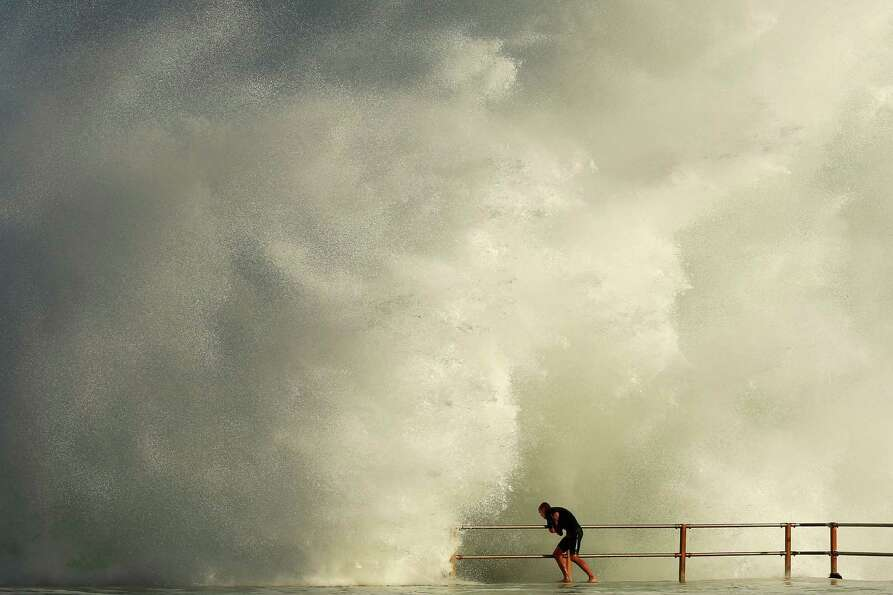 A man hangs onto the railing of North Curl Curl ocean pool Tuesday.