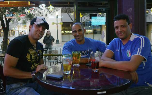 Sports fiends Farid Boucltikui (cq) (from left), Tarek Khoudali (cq) and Abdo Said (cq) watch college basketball over brews at The Ticket on January 27, 2013. Robin Johnson Photo: Robin Johnson