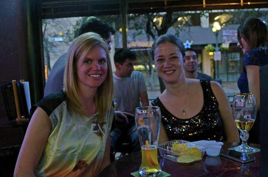 Joanna Rys (cq) and Erin Ealba (cq) have drinks at The Ticket on January 27, 2013. Robin Johnson Photo: Robin Johnson