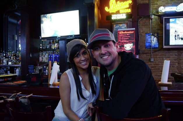 Dan and Brittany Ashe (cq) enjoy a date night with drinks and sports at The Ticket on January 27, 2013. Robin Johnson Photo: Robin Johnson