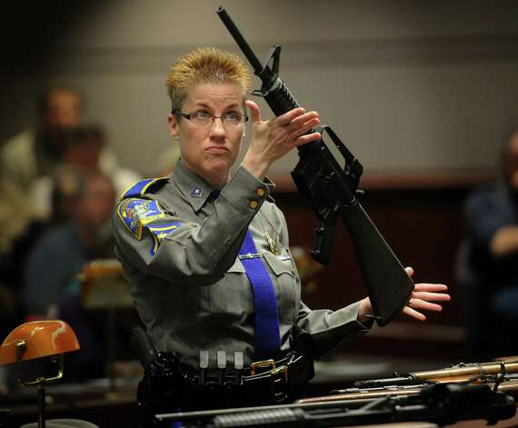 State police Detective Barbara Mattson displays a Bushmaster assault-style rifle, the type used in the Sandy Hook School shooting, during testimony before the Gun Violence Prevention Working Group at the Legislative Office Building in Hartford, Conn. on Monday, January 28, 2013. Photo: Brian A. Pounds