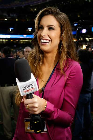 Katherine Webb of 'Inside Edition' smiles on the field during Super Bowl XLVII Media Day ahead of Su
