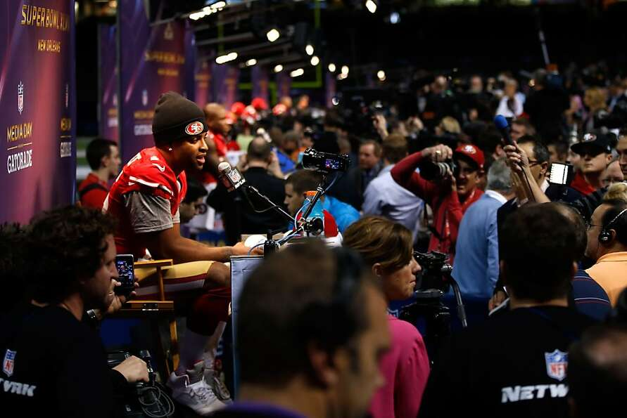 Michael Crabtree of the San Francisco 49ers answers questions from the media during Super Bowl XLVII