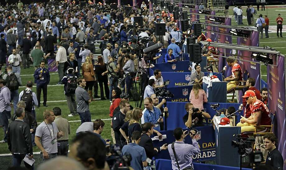 Members of the San Francisco 49ers football team are interviewed by reporters during media day for the NFL Super Bowl XLVII football game Tuesday, Jan. 29, 2013, in New Orleans. Photo: Mark Humphrey, Associated Press