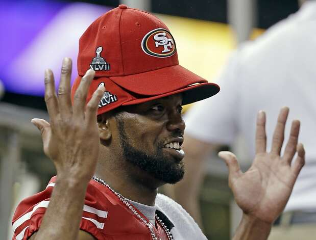 San Francisco 49ers wide receiver Randy Moss wears multiple hats during media day for the NFL Super Bowl XLVII football game Tuesday, Jan. 29, 2013, in New Orleans. Photo: Mark Humphrey, Associated Press
