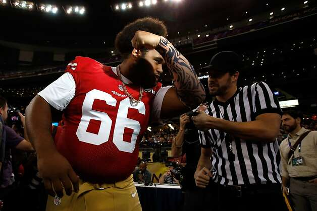 Joe Looney of the San Francisco 49ers kisses his bicep as he is interviewed from the media during Super Bowl XLVII Media Day ahead of Super Bowl XLVII at the Mercedes-Benz Superdome on January 29, 2013 in New Orleans, Louisiana. Photo: Scott Halleran, Getty Images