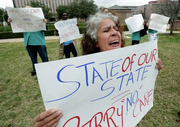 Maria Webster joins others protesting Texas Gov. Rick Perry's stance on health care outside the state capitol where Perry was to deliver the state of the state address, Tuesday, Jan. 29, 2013, in Austin, Texas.  (AP Photo/Eric Gay) Photo: Eric Gay, Associated Press / AP