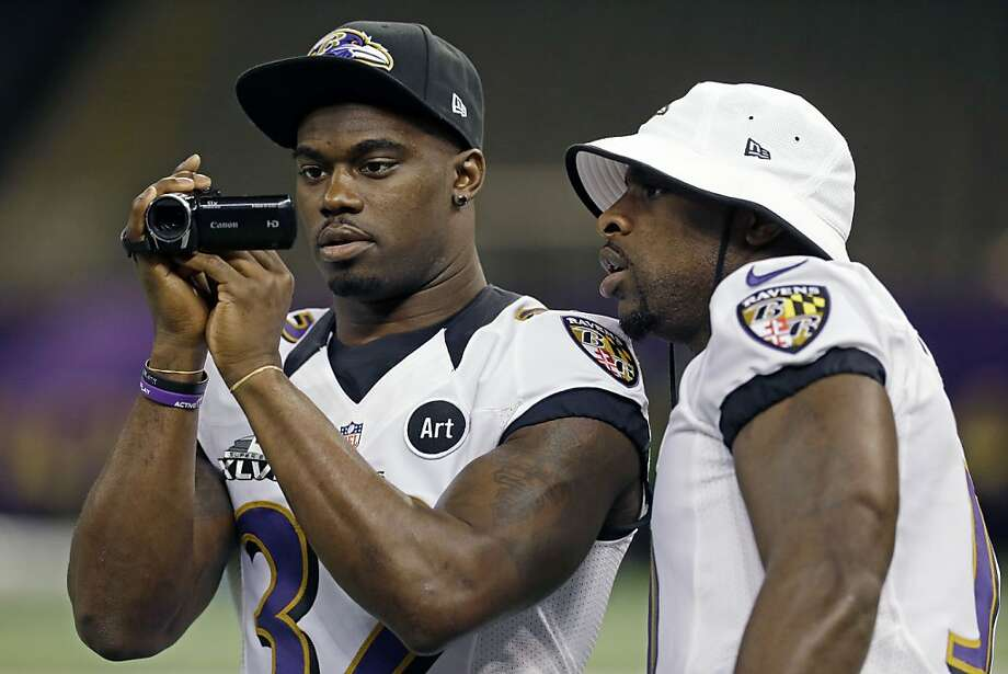 Baltimore Ravens safety James Ihedigbo shoots a video as safety Bernard Pollard, right, looks over his shoulder during media day for the NFL Super Bowl XLVII football game Tuesday, Jan. 29, 2013, in New Orleans. (AP Photo/Mark Humphrey) Photo: Mark Humphrey, Associated Press