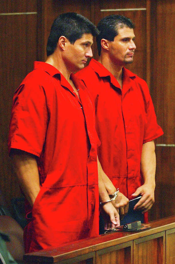 Former Oakland slugger Jose Canseco, right, and his twin brother Ozzie, stand handcuffed together during their hearing in 2003.The less said about this pair the better. Photo: TIM CHAPMAN, ASSOCIATED PRESS / AP2003