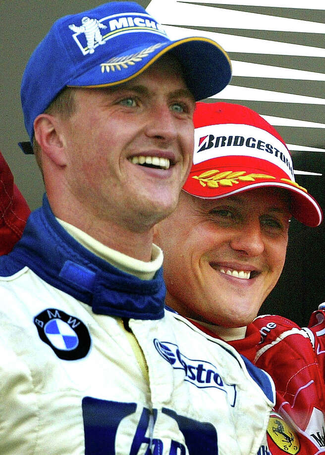 Germany's Ralf Schumacher, left, is the older of the two, but brother Michael Schumacher is widely regarded as one of the greatest drivers of all-time with his seven F1 World Championships. Photo: SHIZUO KAMBAYASHI, ASSOCIATED PRESS / AP2004