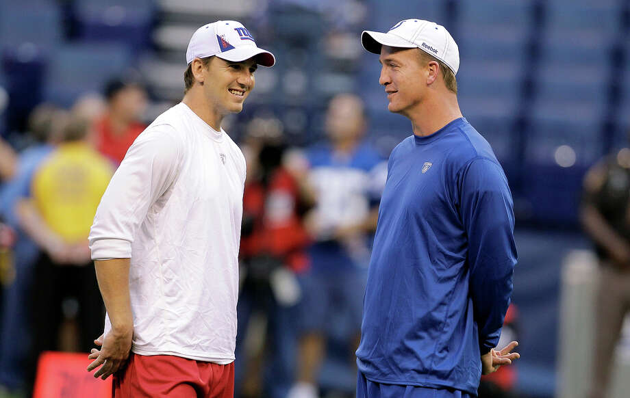 Eli Manning, left,  and Peyon Manning, right, have three Super Bowl rings between them. Photo: Darron Cummings, ASSOCIATED PRESS / AP2010