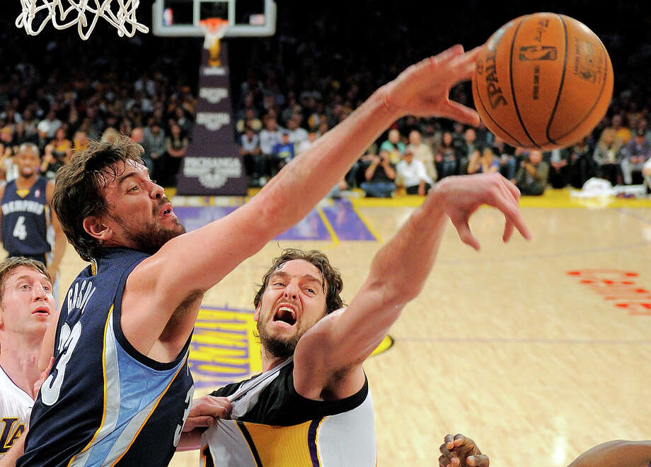 Memphis Grizzlies center Marc Gasol, left, of Spain, has the upper hand in this photo but will always be overshadowed by his brother Los Angeles Lakers forward Pau Gasol. Photo: Mark J. Terrill, ASSOCIATED PRESS / AP2012