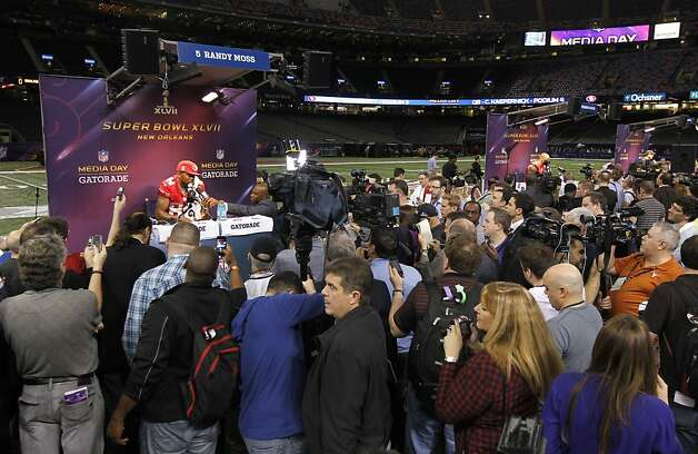 49er Randy Moss,84 talks with reporters as Media Day gets underway at the Mercedes-Benz Superdome the site of this year's Superbowl between the San Francisco 49ers and the Baltimore Ravens in New Orleans, La. on Tues. Jan. 29, 2013. Photo: Michael Macor, The Chronicle