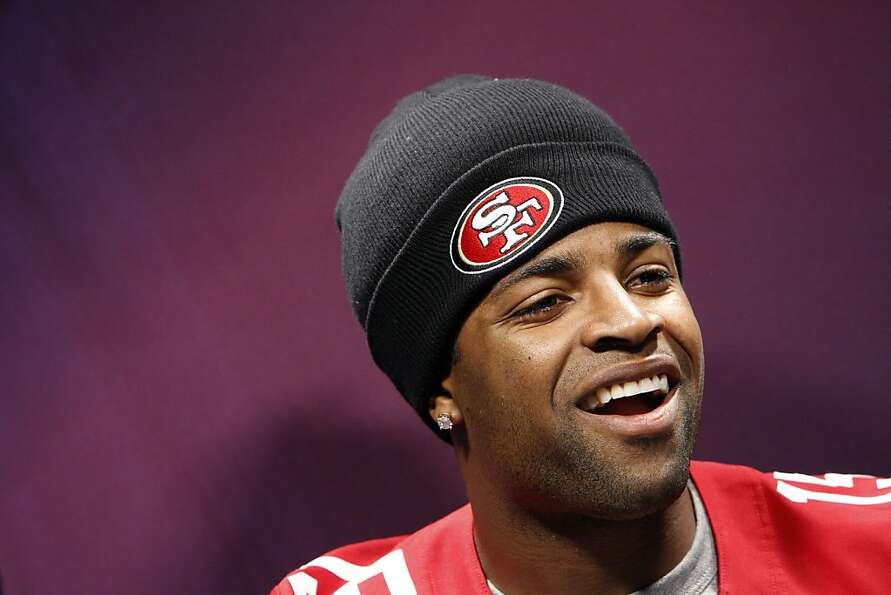 Michael Crabtree answers questions from the press as The 49ers attended media day at the Super Dome