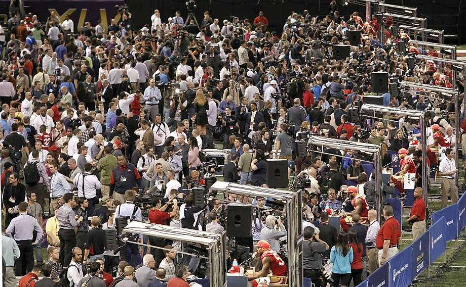 Hundreds crowd the field as the 49ers take their places as Media Day gets underway at the Mercedes-Benz Superdome the site of this year's Superbowl between the San Francisco 49ers and the Baltimore Ravens in New Orleans, La. on Tues. Jan. 29, 2013. Photo: Michael Macor, The Chronicle