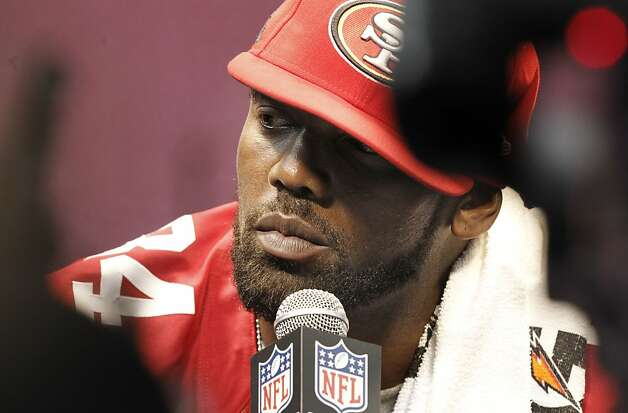 49er Randy Moss, 84 contemplates a question from a reporter as Media Day gets underway at the Mercedes-Benz Superdome the site of this year's Superbowl between the San Francisco 49ers and the Baltimore Ravens in New Orleans, La. on Tues. Jan. 29, 2013. Photo: Michael Macor, The Chronicle