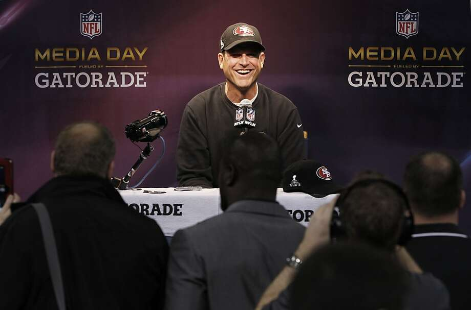 49ers head coach Jim Harbaugh shares a laugh as Media Day gets underway at the Mercedes-Benz Superdome the site of this year's Superbowl between the San Francisco 49ers and the Baltimore Ravens in New Orleans, La. on Tues. Jan. 29, 2013. Photo: Michael Macor, The Chronicle