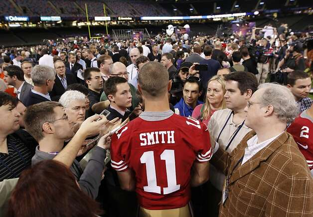 49er quarterback Alex Smith, 11 talks with reporters as Media Day gets underway at the Mercedes-Benz Superdome the site of this year's Superbowl between the San Francisco 49ers and the Baltimore Ravens in New Orleans, La. on Tues. Jan. 29, 2013. Photo: Michael Macor, The Chronicle