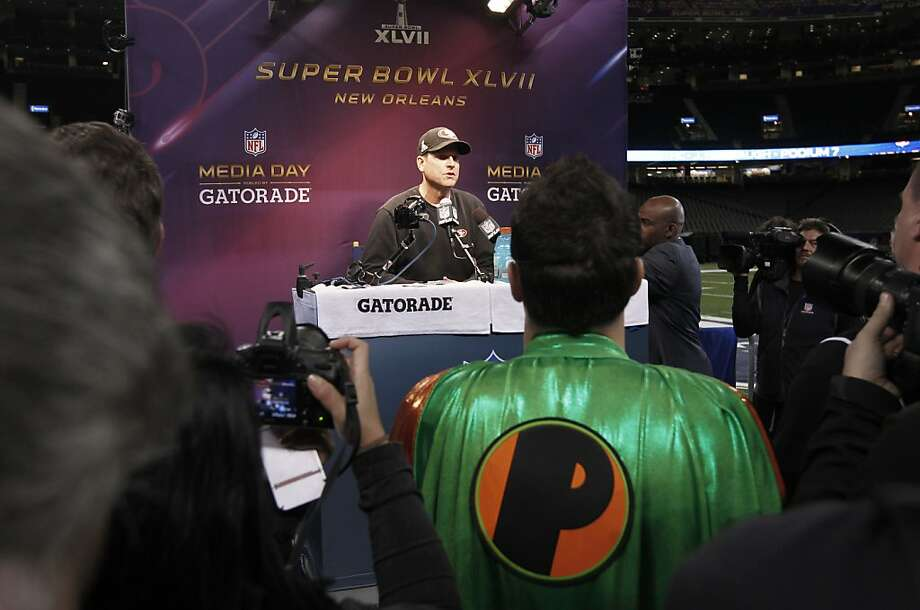 49er head coach Jim Harbaugh talks with reporters as Media Day gets underway at the Mercedes-Benz Superdome the site of this year's Superbowl between the San Francisco 49ers and the Baltimore Ravens in New Orleans, La. on Tues. Jan. 29, 2013. Photo: Michael Macor, The Chronicle